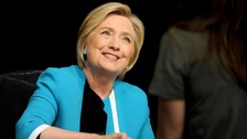 Former U.S. Secretary of State Hillary Clinton signs copies of her new book 'What Happened' at a book signing
