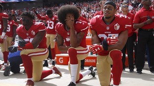 US President Donald Trump criticises NFL players who have been protesting against perceived social injustice