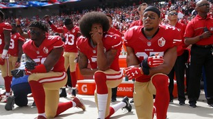 49ers kneel during the national anthem.