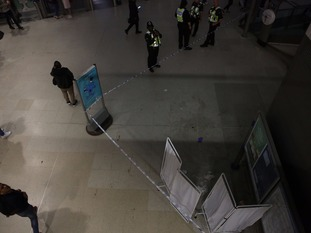 Police at a cordoned off area inside Srtatford Station.