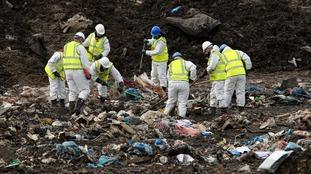 Police search a landfill site at Milton, Cambridgeshire