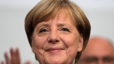 Merkel wins fourth term as far right leaps to third place