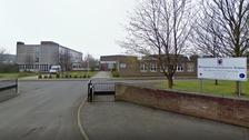 Teenager arrested after staff member stabbed at school