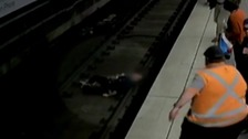 The man fell onto the train tracks.