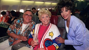 With Joan Collins during the soap's Christmas episode in 1997.