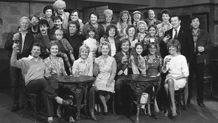 A group shot of the cast in 1985