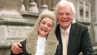 Cherie Booth, the wife of Tony Blair, celebrating with her father Tony Booth outside the High Court after she was sworn in as a QC.