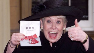 At Buckingham Palace after receiving an MBE in 2000.