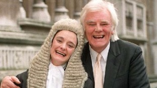 Celebrating with his daughter Cherie Blair after she was sworn in as a QC in 1995.