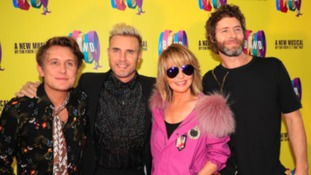 Take That greeted by screaming fans at musical opening