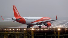 An easyJet plane flying.