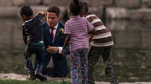 Groom jumps into river to save child in middle of wedding photo shoot