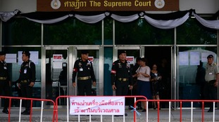 Soldiers stand guard outside Thailand's Supreme Court.