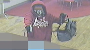 Police release CCTV of armed robbery on bookmakers
