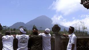 Balinese villagers watch Mount Agung from around 10km away.
