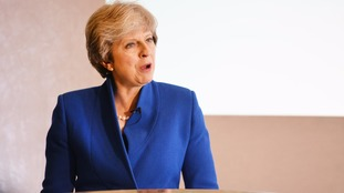 Theresa May mounts strong defence of free market economy