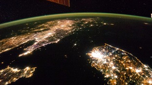 North Korea seen from space by night, it's in virtual darkness compared to its brightly lit neighbours.