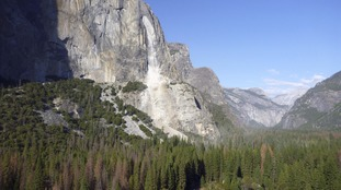 Boulders can be seen falling from rock face in Yosemite National Park.