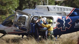 An unnamed woman is rescued after the rock fall.