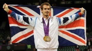 Andy Murray celebrates his Olympic medals