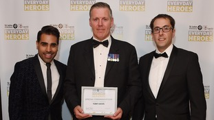 Tony Davis (centre) with his award.