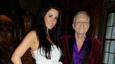 Kerri Parker poses for a picture with Hugh Hefner.