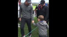 Watch the moment a young golf fan got more than he bargained for