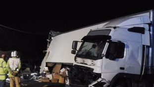 A lorry has spilled its load after being involved in the crash