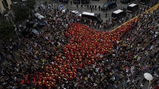 Striking firefighters joined protesters outside the Spanish government delegation.