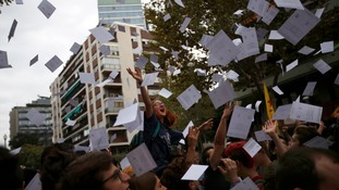 Protesters threw referendum ballots into the air during the city street demonstration.