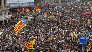 Thousands gathered with many flying their 'esteladas', the Catalonia independence flags.