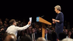Security questions after prankster interrupts May's conference speech