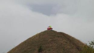 Pranksters place half of car at top of landmark