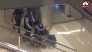 Marilou Danley was seen in a wheelchair after landing back in the US on Tuesday.