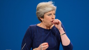 Theresa May coughs during her speech.