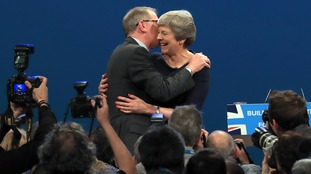 Theresa May is hugged on stage by her husband Philip.