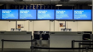 Empty Monarch Airlines check-in desks after the airline went bust.