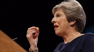 Mrs May was handed a cough sweet by Chancellor Philip Hammond.