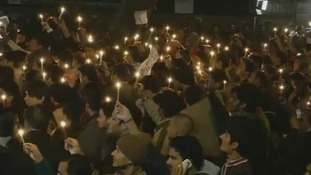 Protesters in New Delhi lit candles in memory of the gang-rape victim who died today