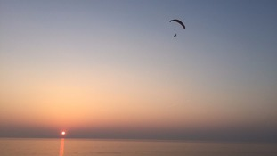 A paraglider during sunset
