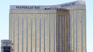 Broken windows at the Mandalay Bay hotel show where Paddock fired from.