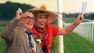 Liz with her soap husband Jack, played by the late Bill Tarmey at the races.