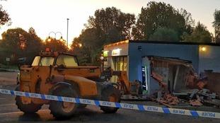 A digger was left abandoned outside the Spar shop.