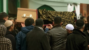 Mourners gather at the funeral of two brother killed in a crash on the M6