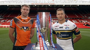 Castleford Tigers captain Michael Shenton (left) and Leeds Rhinos captain Danny McGuire (right) with the Super League trophy.