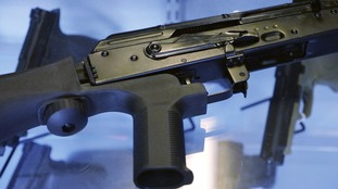 A bump stock is attached to a semi-automatic rifle.