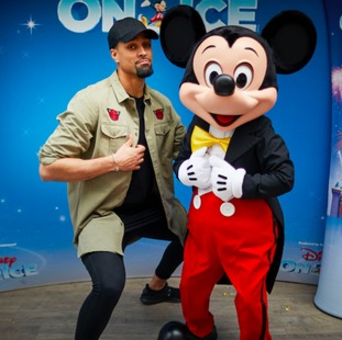 Ashley Banjo, with a cast member of Disney On Ice