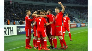 Wales' Tom Lawrence celebrates scoring his side's first goal
