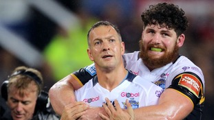 Leeds Rhinos' Danny McGuire celebrates scoring a try with team mate Mitch Garbutt during the Betfred Super League Grand Final at Old Trafford, Manchester.