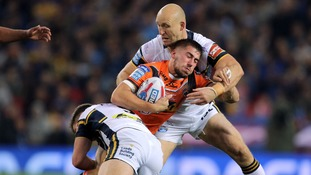 Castleford Tigers' Greg Minikin is tackled by Leeds Rhinos players during the Betfred Super League Grand Final at Old Trafford, Manchester.
